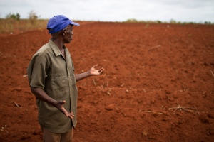 Mzee Rubeni surveys a drought-stricken field in Kwakiliga. Changing rainfall patterns pose a critical threat to farming families in the region.
